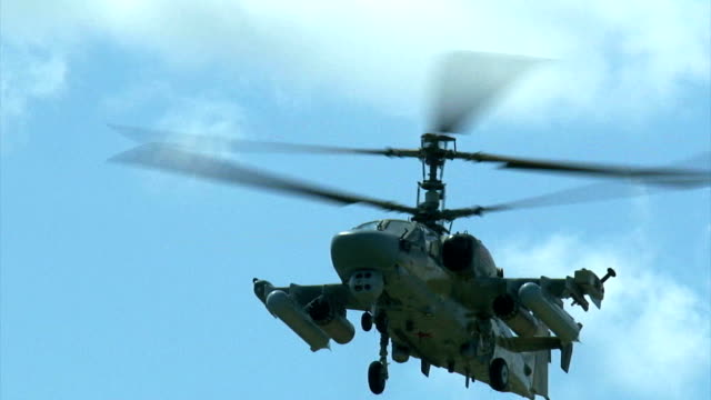 close-up - a military helicopter hovering in flight - air vehicle stock videos and b-roll footage