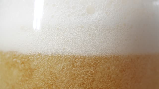 close-up a mug of beer - frothy drink stock videos & royalty-free footage
