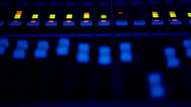 close-up  a sound control desk. audio engineer operates his instrument, recording equipment, during a night show at concert hall - audio equipment stock videos & royalty-free footage