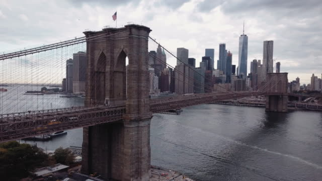 Closeup aerial shot of New York City's Brooklyn Bridge at sunrise on a clouday morning.