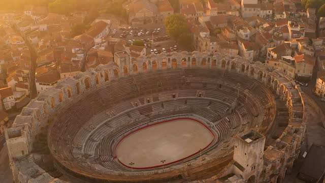 close-up aerial view of the arles amphitheatre at sunrise in arles, in the south of france - amphitheatre stock videos & royalty-free footage