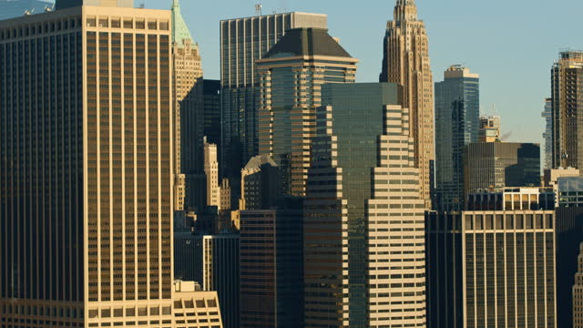 closeup aerials of administrative corporate buildings in downtown manhattan in the early morning. drone video with the panning camera motion. - panning stock videos & royalty-free footage