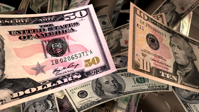 close-up, american currency flying through a warm light (loop) - loss stock videos & royalty-free footage