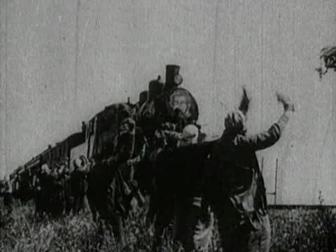 vidéos et rushes de close-up and aerial views of train moving - people welcoming train passengers - locomotive