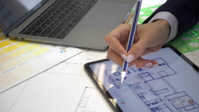 close-up architect working on digital tablet - housing development stock videos & royalty-free footage