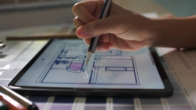 close-up architect working on digital tablet - design studio stock videos & royalty-free footage