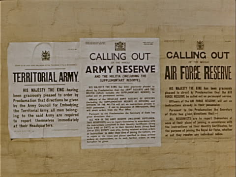 closeup army reserve signs reading 'territorial army' and 'calling out of the whole army reserve' posted during war preparations / london england - western script stock videos & royalty-free footage
