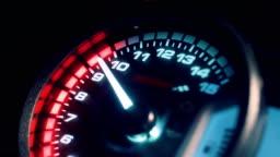 Close-up arrow speedometer of sports bike at high speed.
