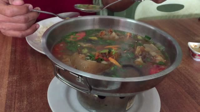 close-up asian man eating delicious spicy stewed oxtail soup - broth stock videos & royalty-free footage