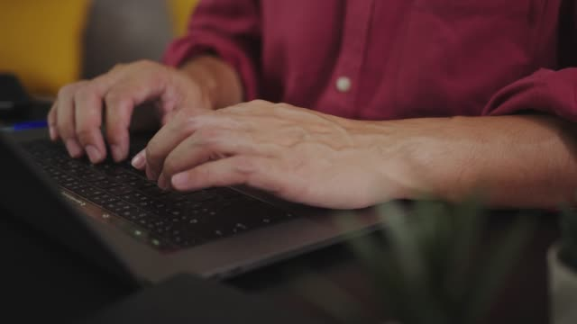close-up asian man hand typing or searching for his research data information on laptop computer while stay home. close-up human finger speed typing e-mail. male hand holding and using digital laptop while working from home or remotely work technology. - human finger stock videos & royalty-free footage