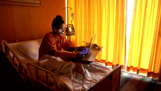 close-up asian man working on the bed in hospital. - scar stock videos & royalty-free footage