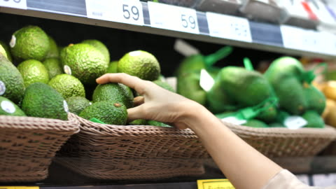 close-up asian woman avocado fruit shopping in supermarket - choice stock videos & royalty-free footage