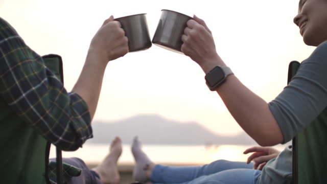 close-up asian woman clinking cups together in camping - cup stock videos & royalty-free footage
