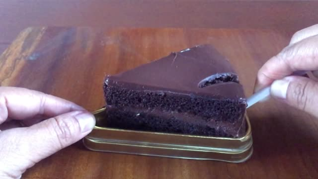 close-up asian woman eating delicious slice of chocolate cake - serving size stock videos & royalty-free footage