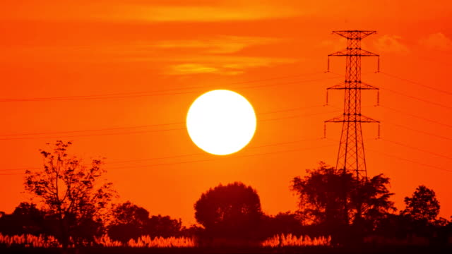 close-up at sunset time lapse - electricity pylon stock videos & royalty-free footage