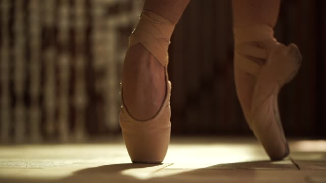 close-up ballerina tying her ballet slippers on - ballet dancer stock videos & royalty-free footage