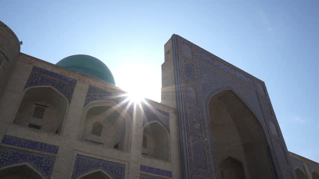 close-up beautiful shot of sunlight falling over madarsa against clear sky - bukhara, uzbekistan - arch stock videos & royalty-free footage