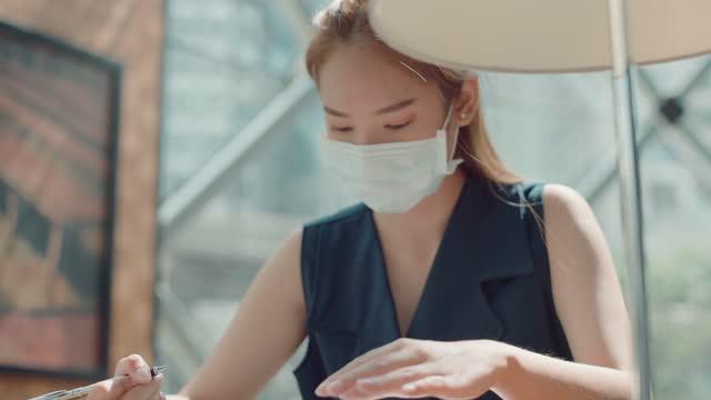 close-up, beautiful woman hand signature on paper. - human limb stock videos & royalty-free footage