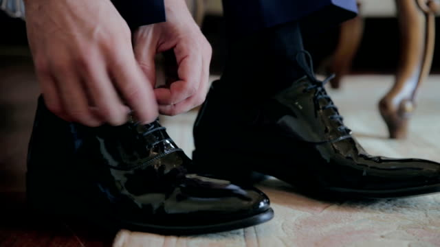 close-up black shoes dressing - sock stock videos & royalty-free footage