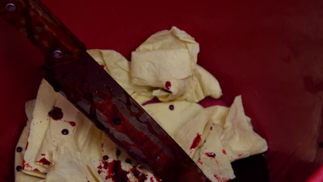 close-up bloody knife in a bin - dagger stock videos & royalty-free footage
