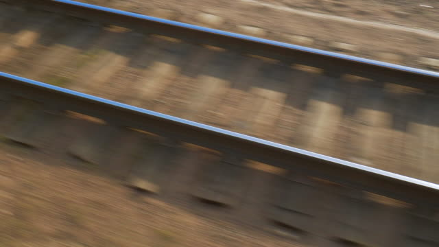close-up: blur motion of empty railroad track during sunny day - ulaanbaatar, mongolia - independent mongolia stock videos & royalty-free footage