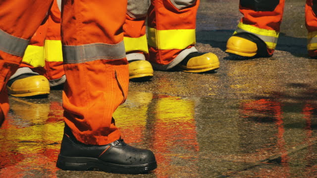 slo mo close-up boots shot of firefighter - inferno stock videos & royalty-free footage
