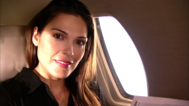 close-up businesswoman reading newspaper in private jet/ miami, florida, usa - vehicle seat stock videos & royalty-free footage