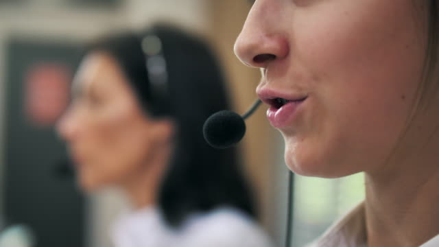 close-up call center working using a headset - 1920 stock videos & royalty-free footage