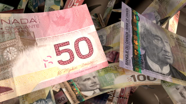 close-up, canadian currency flying through a warm light (loop) - currency stock videos & royalty-free footage