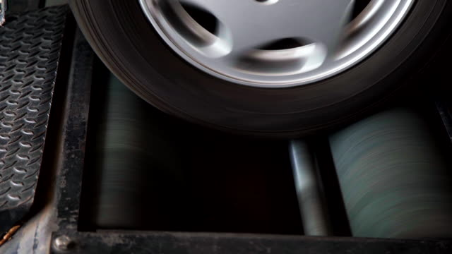 closeup car check brake testing service. - wheel stock videos & royalty-free footage