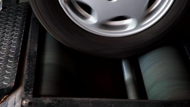 closeup car check brake testing service. - calliper stock videos and b-roll footage
