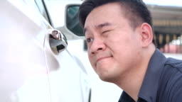 4K Close-up Car cleaning staff He is using yellow Microfiber cloth. Wipe the white car clean in the car wash shop