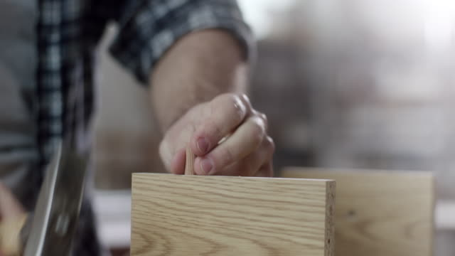 close-up, carpenter using hammer to assemble piece of furniture - hammer stock videos and b-roll footage