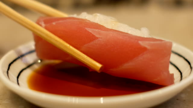 Close-up chopstick with sushi