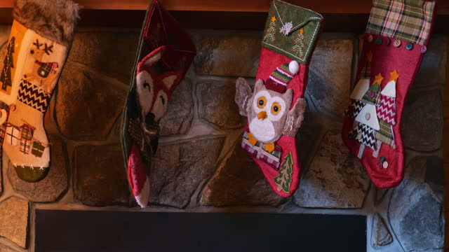 close-up, christmas stockings over a fireplace, north carolina, usa - stockings stock videos & royalty-free footage