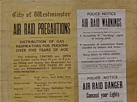 closeup city of westminster air raid signs reading 'air raid precautions' 'air raid warnings' and 'air raid danger' posted during war preparations /... - western script stock videos & royalty-free footage