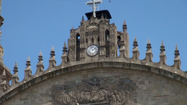close-up: clock of the cathedral on the facade - cathedral stock videos & royalty-free footage