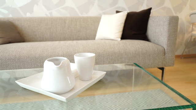 closeup coffee table in living room - coffee table stock videos & royalty-free footage