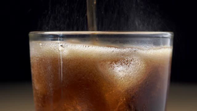 4k close-up cola soft drink, cool water. - cup stock videos & royalty-free footage