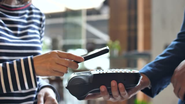 close-up contactless payment with mobile phone, mobile payment - mobile payment stock videos & royalty-free footage