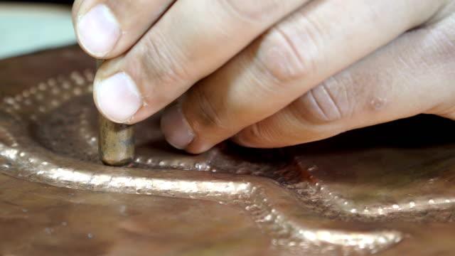 Close-up copper-smith work.