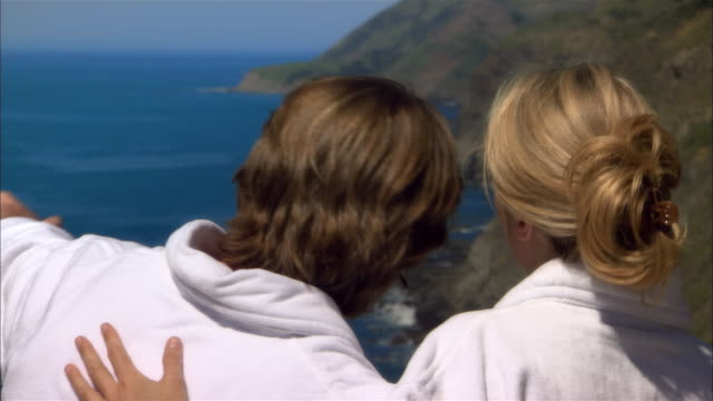 close-up couple looking at view near sea/ monterey county, california, usa - ragged point stock videos and b-roll footage
