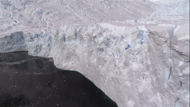 close-up crevasses forming in glacier along coast of antarctic sea/ antarctica - crevasse stock videos & royalty-free footage