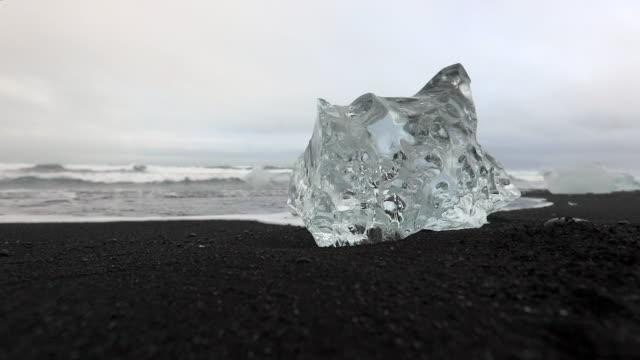 close-up: crystal like ice on diamond beach iceland - ice crystal stock videos and b-roll footage