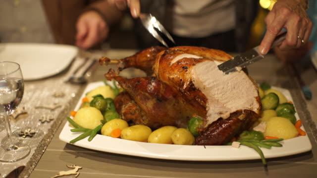 closeup cutting and serving roasted turkey - roast turkey stock videos & royalty-free footage