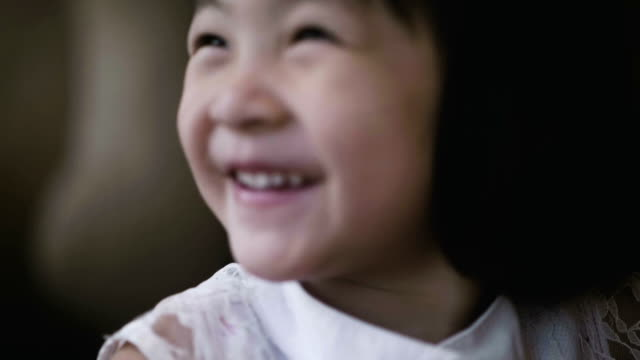 close-up daughter smiling - innocenza video stock e b–roll