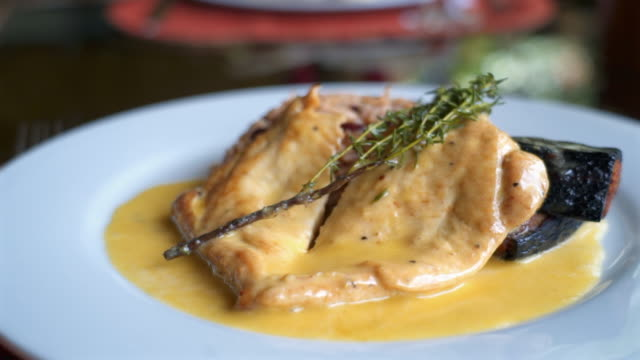 close-up: delicious meat in yellow sauce with herb and garnish - garnish stock videos & royalty-free footage