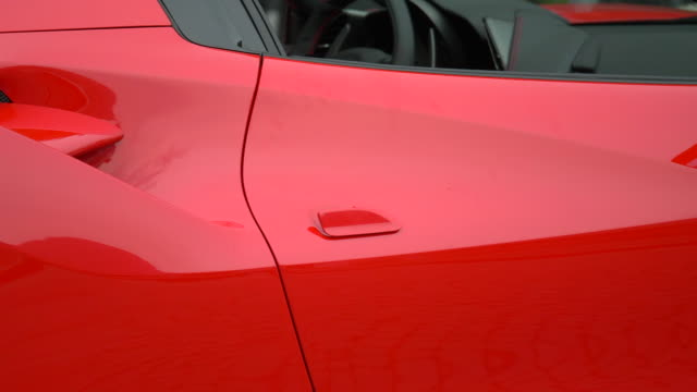 Close-up details of a fast red sports car in Italy, Europe. - Slow Motion