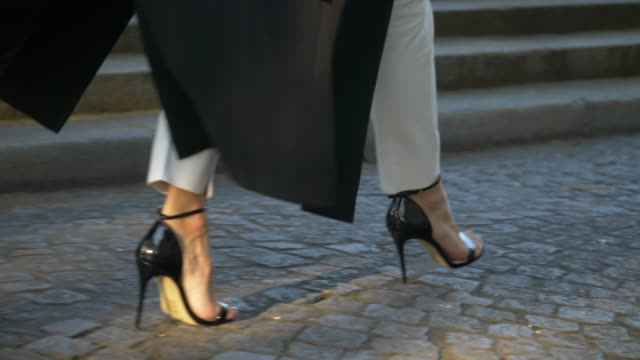 close-up details of a woman feet walking in high heel shoes on a cobblestone street. - foot stock videos & royalty-free footage