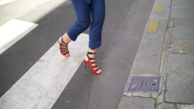 close-up details of a woman feet walking in red high heel shoes on a cobblestone street. - cobblestone stock videos & royalty-free footage